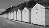 Little Boxes by the Seaside (clive_metcalfe) Tags: bournemouth beachhuts beach undercliff dorset uk seaside wood wooden cliff summer