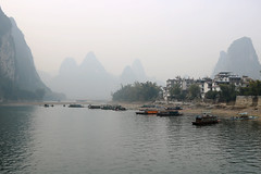 Lijiang river on the way to Guilin, China (Katie Raymer) Tags: china river lijiang boats boat mountains mist fog travel travelling guilin lijiangriver