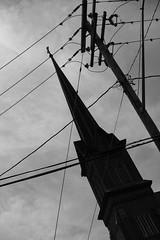 Church Steeple And Powerlines (Duncan Rawlinson - Duncan.co) Tags: 1hggndxerofqdr71ofeykysidbx1ptdg9y driveacrossusasummer2017 duncanrawlinson duncanrawlinsonphoto duncanrawlinsonphotography duncanco photobyduncanrawlinson sony sonya7rii sonyα7rii summer2017 takenwithasonya7rii takenwithasonyα7rii blackandwhite church dark darkness electricity energy httpsduncanco httpsduncancochurchsteepleandpowerlines httpsblockchaininfotxe6f7d226efa91d3670b30be647359ea7f6946 pole powerlines religion religious sadness sky mountmorris newyork unitedstates us httpsblockchaininfotxe6f7d226efa91d3670b30be647359ea7f69469e9b1e6709be6157e59e485e1ef