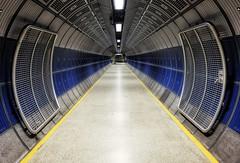 Eddies in the space-time continuum (Douguerreotype) Tags: futuristic scifi london england blue uk symmetry underground urban british gate architecture city tunnel britain subway gb metro tube station