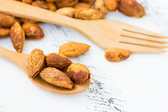 Raw Crispy Almonds on Wooden Spoon on White Wooden Board (visutsrikalong) Tags: almond almonds background blackground brown cashews close closeup cracked delicious diet eating food fresh fruit gourmet group healthy heap ingredient isolated macro natural nature nobody nut nutshell object peeled raw seed snack spoon sweet tasty texture up white wood wooden