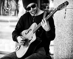 Street Musician (Skeptiq_1) Tags: nikond700 nikon nikkor d700 photo photos photography fx fullframe bw black white blackwhite whiteblack monochrome day light street urban city musician guitarist guitar performer people man socal california usa unitedstates nikon70200f28vr 70200 f28 vr