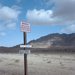 have ample supplies. mojave desert, ca. 2018. (eyetwist) Tags: eyetwistkevinballuff eyetwist landscape sign desert california warning caution mamiya 6mf kodak portra 160 mamiya6mf kodakportra160 75mm mamiya75mmf35l ishootfilm analog analogue film emulsion mamiya6 square 6x6 mediumformat 120 filmexif iconla lenstagger epsonv750pro ishootkodak mojave mojavedesert highdesert medium format roadsideamerica dust dirt wasteland american west rural midland gypsum blythe arrow rice directions type typography typographic roadsign road gas oil water supplies lost middleofnowhere midlandriceroad lonely vast empty signpost