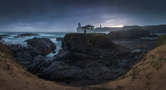 Virxe do Porto (Galicia, Spain) (Tomasz Raciniewski) Tags: virxe do porto galicia spain seascape landscape panorama pano blue ocean outdoor shore coast ermita church rocks light cloudy water sea sky clouds d7200 beach sand grass rock le longexposure wide lighthouse faro