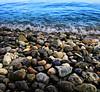 Cast in stones... (Robyn Hooz) Tags: memories ciottoli sassi ricordi acqua lago garda dream macro onde waves you