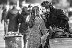 Boy and girl kissing in the city of love (De Mi Ser) Tags: candid street city urban girl man love kiss monochrome blackandwhite