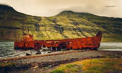 Mjóifjörður (Javier PerezZ) Tags: iceland landscape hill mountain range sunrise horizon over land valley scenic scenics dramatic sky ridge fog fjord boat aground oxide