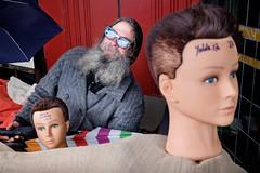 Doorway Camping (johnjackson808) Tags: mannequins vancouver fujifilmxt1 wbroadway streetphotography man people kitsilano homeless headsumbrella