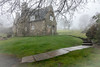Stoneywell in springtime fog (Brian Negus) Tags: curve artsandcrafts grass path spring cottage stoneywell flowers masonry nationaltrust mist tree leicestershire daffodils foggy chimney fog