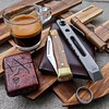 Trestle Pine Topper, Zach Wood prybar, Wasteland Oddities Zippo (edcbyfrank) Tags: everydaycarry edc trestlepinetopper trestlepineknives slipjoint knife zachwood prybar wastelandoddities zippo nutsacbags nutsac wallet foursevenspreonp1 flashlight espresso
