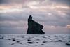 Hjörleifshöfði (BurlapZack) Tags: southernregion iceland is hjörleifshöfði pentaxk1 pentaxhddfa28105mmf3556eddcwr vscofilm pack01 ship ships boulder inletmountain beach blacksandbeach snow winter ice clouds pink skies travel vacation nature otherworldly mountain westeros ocean shore sea crag craggy cliff geological formation basaltcolumn vesturskaftafellssysla