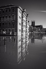 Worcester South Quay.jpg (JuSlaughter) Tags: severn worcester cathedral restaurant reflection mono south november worcestershire monochrome river flood black browns water swan quay white