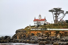 Battery Point Lighthouse (pandt) Tags: lighthouse light california batterypoint crescentcity ocean sea coast coastal rocks rocky clouds overcast water trees red white green outdoor landscape travel canon eos 7d slr flickr photo rock grass sky flag house island