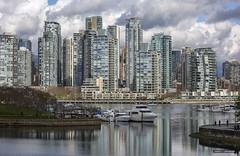 Little People, Big World (Clayton Perry Photoworks) Tags: vancouver bc canada spring explorebc explorecanada skyline seawall reflections falsecreek boats