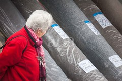 5D13_2084-2 (bandashing) Tags: hyde tameside market civicsquare sylhet manchester england bangladesh bandashing aoa socialdocumentary akhtarowaisahmed red carpets rolls grey look away
