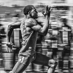 PURPOSE (WilsonAxpe) Tags: determination focus strength purpose athletics track panning mono black white sprint dash 100m colorado denver athlete 100mdash sprinter