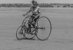 Penny Farthing for ladies a B W (Bev-lyn) Tags: wheels bikes bw lady outdoors vintagenhill airport