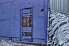 Old Blue Building With Bent Fence (Modkuse) Tags: photoart oldwood oldbuilding peeling paint canon canon50mm canonae1 canonslr transparency fujichrome fujivelvia fujichromevelvia