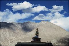 Isolated Splendour (channel packet) Tags: india ladakh jammu kashmir buddha statue nubra valley diskit blue sky clouds mountains desert silhouette davidhill