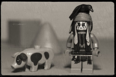 Tonto with his pig (N.the.Kudzu) Tags: tabletop lego minifigures tonto pig bw sepia canondslr lensbabyvelvet56 dxoopticspro11 primelens manualfocus