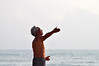 Welcome the sun (Roving I) Tags: elderly aged exercise gestures yoga taichi barechests beaches greyhair concentration morning fitness health sea haze horizon hands eyesclosed lifestyle danang vietnam