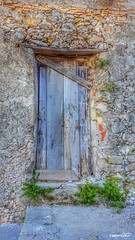 old doors (Massimo Vitellino) Tags: olddoors outdoors wall house structure perspective noperson city abstract contrast conceptual lights shadows hdr colors