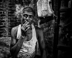 Enjoying a smoke. I met this man working in the vegetable wholesale market in Kolkata. (Gerrykerr) Tags: peoplestreet market mono calcutta kolkata india ngc