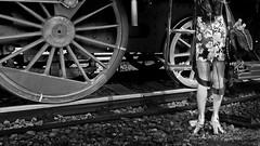 old and young (heinzkren) Tags: schwarzweis blackandwhite bw sw monochrome panasonic lumix perchtoldsdorf dampflokomotive lok steamlocomotive rail geleise lines woman lady feet füsse frau street streetphotography historisch dampflok rad räder iron eisen vehicle eisenbahn railway train kaltenleutgebenerbahn rails wheel