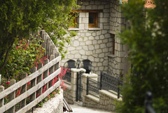 Metsovo (jimiliop) Tags: town village street flowers gardens houses alley stone architecture epirus greece fence focus