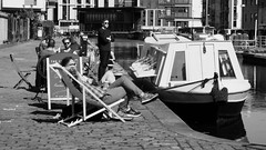 cafe on the canal 01 (byronv2) Tags: cafe canal thecounter blackandwhite blackwhite bw monochrome peoplewatching candid street spring sunny sunshine sunlight sitting seated coffee sunbathing relaxing viewforth tollcross fountainbridge unioncanal towpath people sit