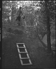 andrew watering landing (Garrett Meyers) Tags: pentax67 mediumformat 6x7 trails bmx dirtjumps ladder dog dirt jumps kodak kodakfilm trix kodaktrix homedeveloped blackandwhitefilm film 120 building jump tx filmphotographer