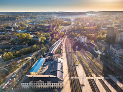 Vilnius panoramic view with train station and tracks  in the morning (spot-on.lt) Tags: shadow sunny rail landscape church baroque cityscape panorama lithuania morning hills drone road oldtown trees tower car sky belltower sunrise spring europe geometry vilnius travel above aerial architecture building capital hill sunshine train transportation vehicle