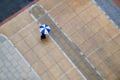 The blue & white umbrella (ovajanel) Tags: rain umbrella spring water street aerial urban city design architecture new people lines creative art contemporary photography square concrete tamrom lens minimal minimalism minimalist plastic white blue black composition