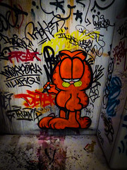 Waiting (Steve Taylor (Photography)) Tags: morpork pest5 freak iilurq garfield marker sharpie drtruant deter prickles cat cartoon graffiti tag streetart black yellow red orange calm fun contrast concrete newzealand nz southisland canterbury christchurch city outline