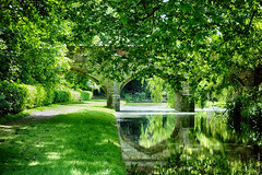North Bridge (Ian Smith (Studio72)) Tags: rx100 sonyrx100 sony uk england london eltham elthampalace moat water river bridge englishheritage crossing 15thcentury medieval green trees leaves reflections ripples shadows sunshine sunlight nature natural scene picturesque spring springtime grass studio72