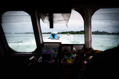 The convoy (andrewchewcc) Tags: boats sea singapore palauubin waves boat window water boatman sky island