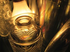 welcoming party (margeois) Tags: abstract stg glass goldenglow reflections iridescent nakedbulb bottle bottles gold golden