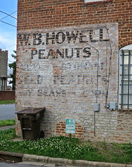 W.B. Howell, Tarboro, NC (Robby Virus) Tags: tarboro northcarolina nc wb howell peanuts ghost sign signage ad advertisement seed storage soy beans brick wall faded