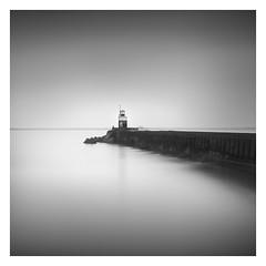 At sea (Marco Maljaars) Tags: pier seascape longexposure le blackandwhite bw marcomaljaars monochrome wijkaanzee water sea mood light house lighthouse