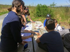 Students learning about animal tracks (BC Wildlife Federation's WEP) Tags: outreach bcwf education wetlands wetlandseducationprogram bcwildlifefederation booth interactive school students surrey surreybendregionalpark metrovancouver