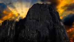Sentinel Rock (Yaecker Photography) Tags: lenstagger yosemitenationalpark park yosemitevalley california unitedstates us storm sunrisesunset sunriseandsunset rocks mountains sentinel rock yellow rayoflight