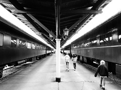 can't get there from here (KevinIrvineChi) Tags: chattanooga choochoo choo station vanishing point distance kids tennessee black white blackwhite bw bnw noir et blanc monochrome railcar hotel store lantern lamps platform canopy post column