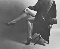 Trish 1C (neohypofilms) Tags: vintage retro portrait style fashion sexy classic 50s 60s 70s tall long legs heels coat dress hair bw blackandwhite 120 medium format film hasselblad studio model girl female woman women gritty grainy raw edgy light shadow contrast
