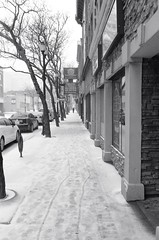 "The Ice Storm series: Alone on Main Street (Xsbmrnr (Please read profile before ""following"") Tags: acros100 acros blackandwhite bandw downtown 35mm 35mmfilm film filmphotography hamilton hamiltonontario hamont hc110 ice olympusom1 olympus om1 people street streetphotography urban urbanphotography zuiko zuiko35mm"