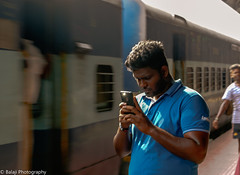 Candid - Mobile phone user (Balaji Photography - 4.8M views and Growing) Tags: mobilephones cellphone userbehaviour railwaystation publicplaces travel mobile salem salemjunction