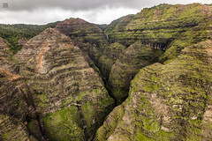 Kauai Heli Tour - Green Hills (lycheng99) Tags: helicopter maunaloahelicopter maunaloahelicoptertours travel mountains hills green valley waterfall rocks rockformation volcanicrocks volcano nature landscape kauai hawaii aerialview aerial