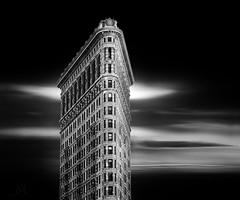 Flat Iron building, NYC (marianna_a.) Tags: p1340689 flatironbuilding nyc newyork usa architecture monochrome blackandwhite greyscale urban building dark motionblur mariannaarmata monochromemonday