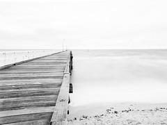 Seaford Pier (Thunder1203) Tags: bnw bay beach beachesofaustralia beachesoftheworld blackandwhite choppysea clouds hdr hoyafilters longexposure monochrome ndfilter portphillipbay sand seafordpier thesea waves nrgativespace stark