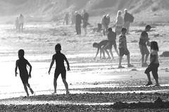 Beach life (Wilamoyo) Tags: northwales streetpubliccommunity people beach mist fog children sea sand bw blackandwhite play activity mono monochrome