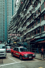 The red cab of Quarry Bay. (Matthias Dengler || www.snapshopped.com) Tags: matthias dengler snapshopped urban street hong kong china cab taxi red dirty movie cinematic building city cityscape streets documentary travel explore create